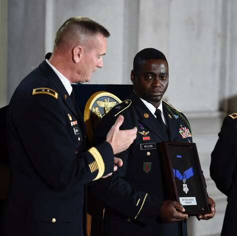 The Congressional Medal of Honor comes to Albany NY for WWI hero Henry Johnson with an  assist from two Major General Patrick Murphy, the adjutant general of New York, and New York Army National Guard Command Sgt. Major Anthony McLean, the command sergeant major of the 369th Sustainment Brigade, the unit which carries the lineage and honor of the 369th Infantry Regiment, the Harlem Hellfighters, in which Henry Johnson served in 1918. (Skip Dickstein / Times Union)