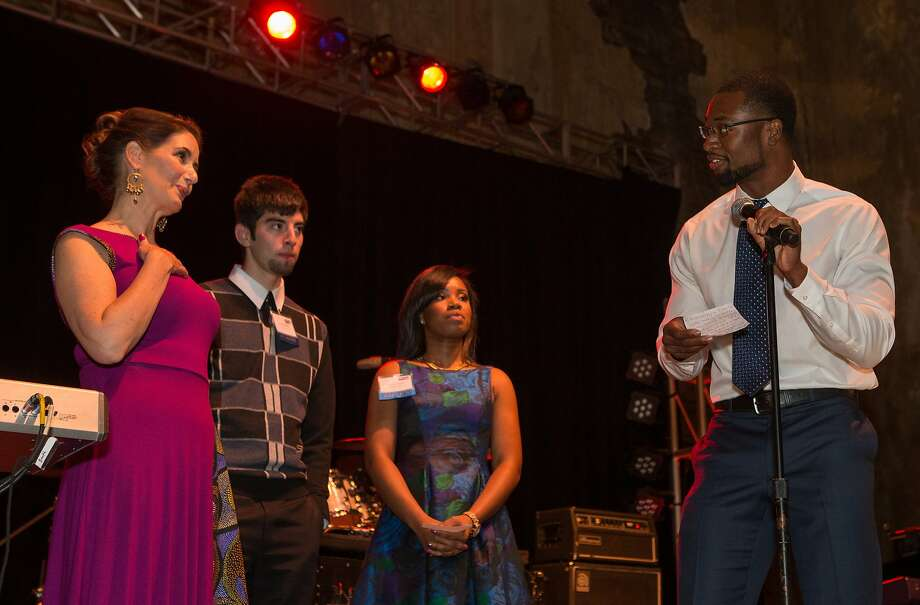 Libby Schaaf joins alumni of the East Bay College Fund, from left, Isidro Ruvalcaba, Victoria Barnes and Michael Jefferson on stage on Saturday, Nov. 7, 2015 in Oakland, Calif. Photo: Nathaniel Y. Downes, The Chronicle