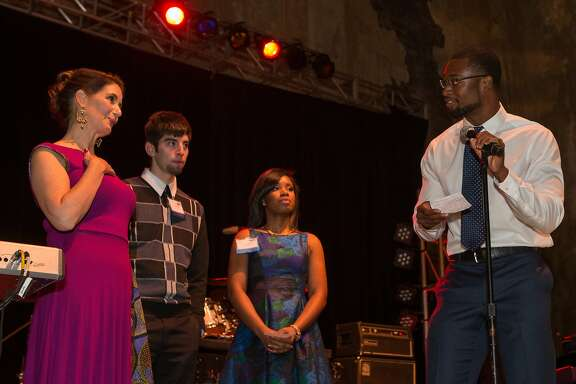Libby Schaaf joins alumni of the East Bay College Fund, from left, Isidro Ruvalcaba, Victoria Barnes and Michael Jefferson on stage on Saturday, Nov. 7, 2015 in Oakland, Calif.