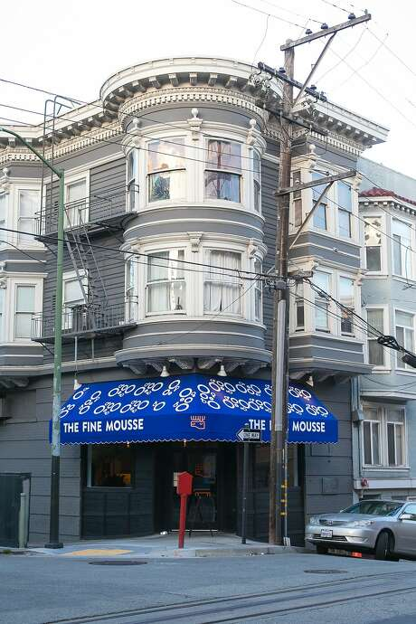 The bright blue awning of the Fine Mousse on the corner of Jackson and Taylor streets in San Francisco. Photo: Jen Fedrizzi, Special To The Chronicle