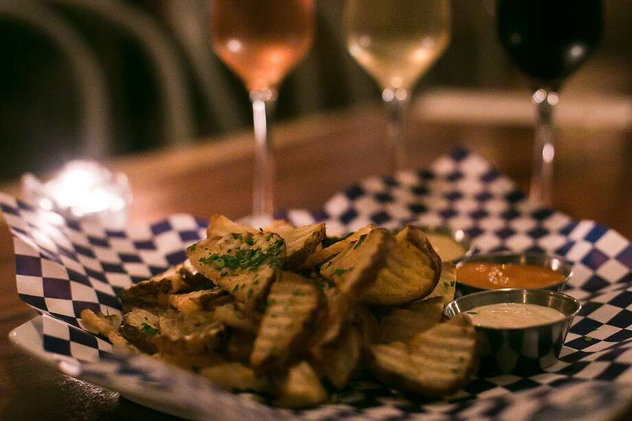 The Fine Mousse in the Nob Hill area of S.F. specializes in the pairing of Champagne and sparkling wines with french fries. Photo: Jen Fedrizzi, Special To The Chronicle