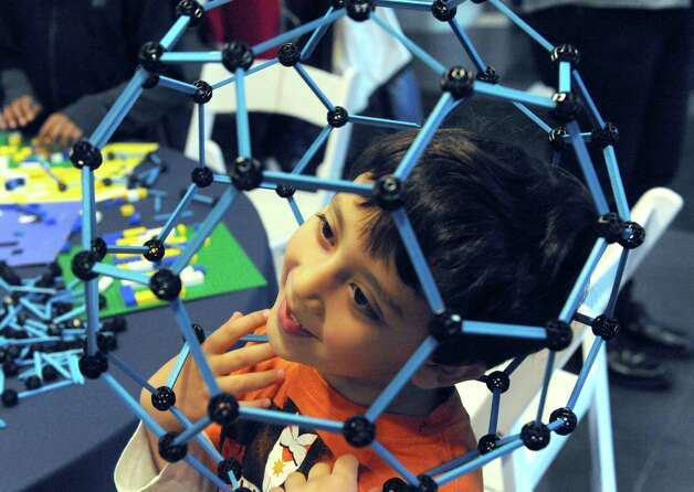 Five-year-old Joseph Robert LeWinter of Watervliet gets his head into a geodesic construction during SUNY Polytechnic InstituteOs Colleges of Nanoscale Science and Engineering family day on Saturday Nov. 7, 2015 in Albany, N.Y.  (Michael P. Farrell/Times Union) Photo: Michael P. Farrell / 00034122A