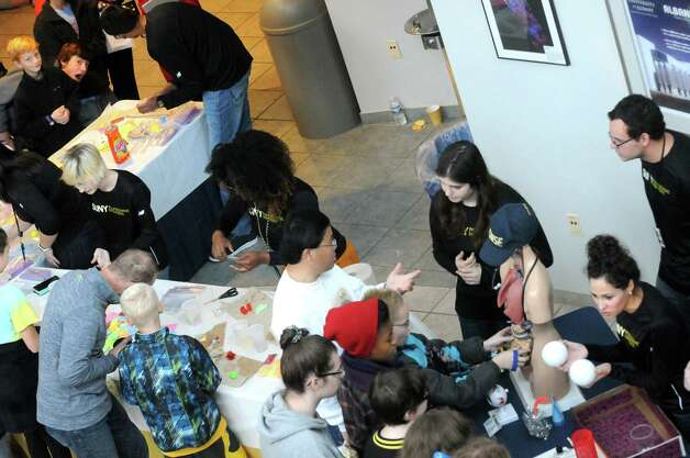 Graduate students on hand to explain an abundance of current technology during SUNY Polytechnic Institute's Colleges of Nanoscale Science and Engineering family day on Saturday Nov. 7, 2015 in Albany, N.Y.  (Michael P. Farrell/Times Union) Photo: Michael P. Farrell / 00034122A