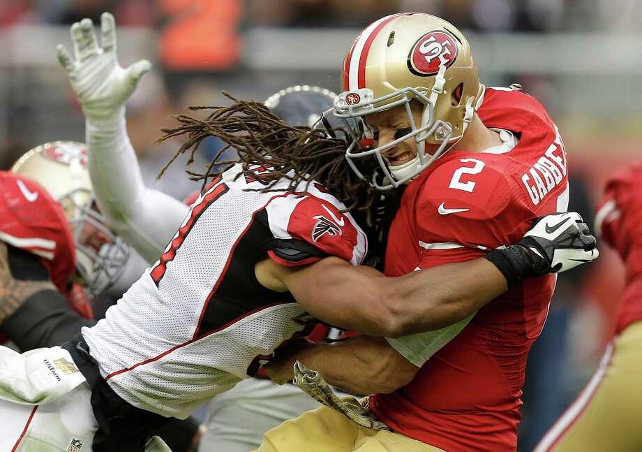 Falcons linebacker Philip Wheeler hits 49ers quarterback Blaine Gabbert during the fourth quarter Sunday. Photo: Ben Margot / Associated Press / AP