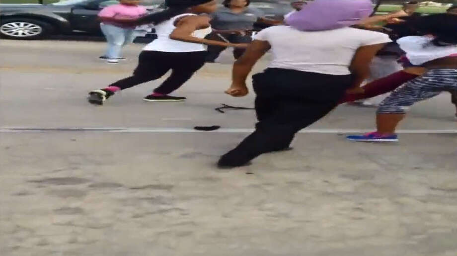 A car plows through a group of middle school girls engaged in a schoolyard brawl in Houston, dragging one for several yards. Photo: Via Twitter