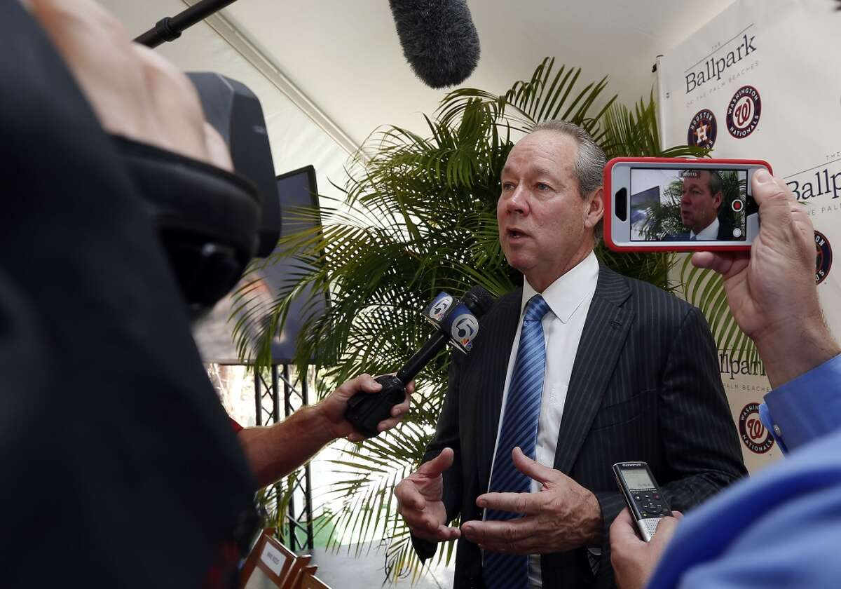 Houston Astros owner Jim Crane fields questions from reporters after the groundbreaking ceremony for the future home of the of Houston Astros and the Washington Nationals spring training facility on Monday, Nov. 9, 2015, in West Palm Beach, Fla. (AP Photo/Steve Mitchell)