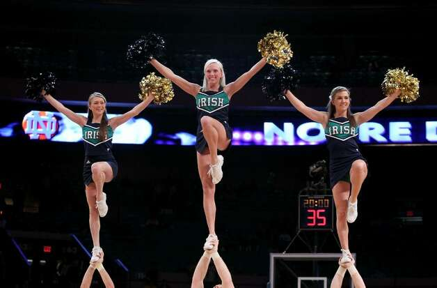 NEW YORK - MARCH 11: The Notre Dame Fighting Irish cheerleaders perform against the Pittsburgh Panthers during the quarterfinal of the 2010 NCAA Big East Tournament at Madison Square Garden on March 11, 2010 in New York City.  (Photo by Jim McIsaac/Getty Images) Photo: Jim McIsaac, Getty Images / 2010 Getty Images