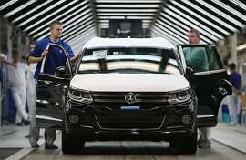 (FILE PHOTO) Volkswagen is expected to offer cash to around 500,000 owners of VW and Audi diesel cars equipped with illegal software in the United States in the coming week. WOLFSBURG, GERMANY - OCTOBER 21:  Workers conduct final inspections and prepare finished Volkswagen cars for transport at the end of the assembly line prior to a visit by Volkswagen Group Chairman Matthias Mueller and Lower Saxony Governor Stephan Weil at the Volkswagen factory on October 21, 2015 in Wolfsburg, Germany. The two toured the plant and met with workers as Volkswagen continues to struggle through the wake of the Volkswagen diesel emissions scandal. The company installed software that cheats during emissions test into 11 million of its diesel cars sold worldwide.  (Photo by Sean Gallup/Getty Images)