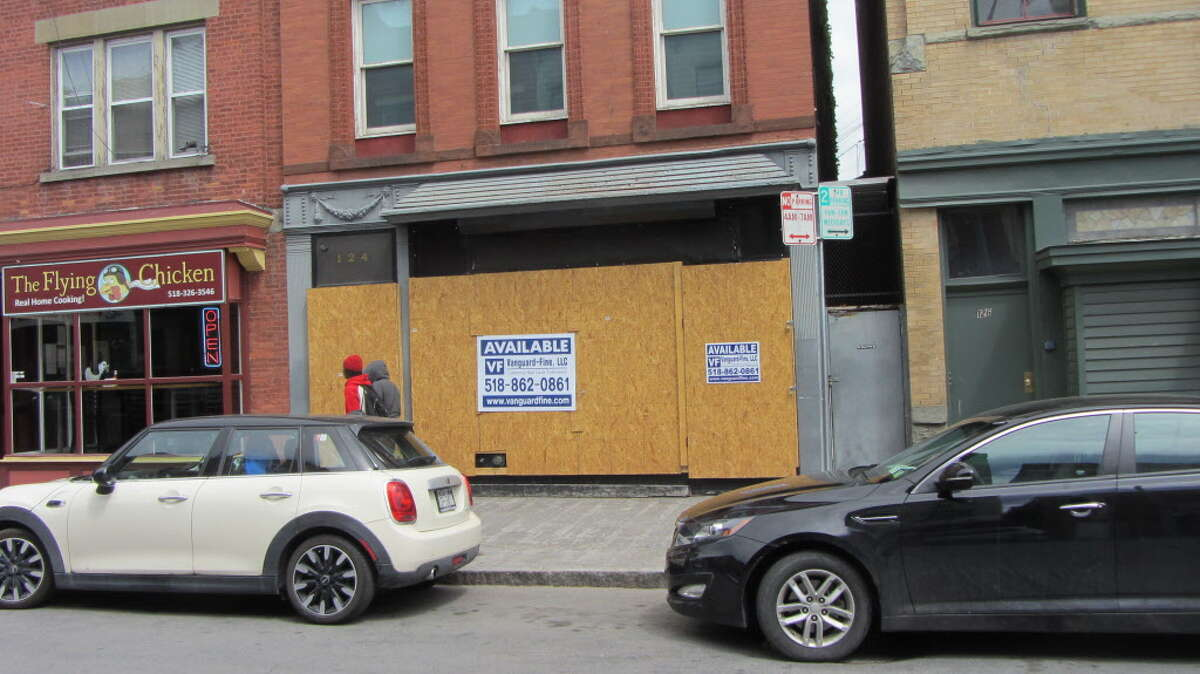 The former Kokopellis night club at 124 Fourth St., Troy, is boarded up while a block away its owner was arraigned Wednesday, May 20, 2015, in Rensselaer County Court on assault and weapon charges. (Bob Gardinier/Times Union)