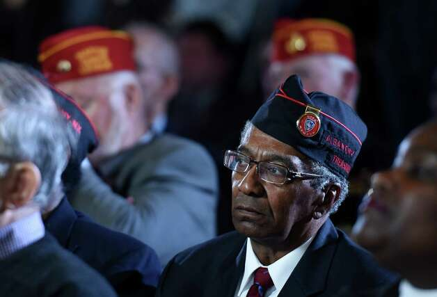 Henry Shadrick of the Albany 369th Veterans Associations  at the opening of an exhibit posthumously honoring St. Henry Johnson, an Albany resident whose World War I heroism was recognized locally with the award of the Medal of Honor during a ceremony in the War Room at the State Capitol  Monday morning Oct. 9, 2015 in Albany, N.Y.  (Skip Dickstein/Times Union) Photo: SKIP DICKSTEIN / 10034142A