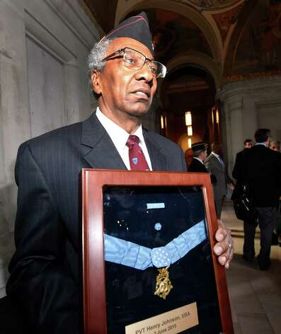 Henry Shadrick of the Albany 369th Veterans Association and one of the driving forces behind the Medal of Honor being given to Sgt. Henry Johnson holds that very medal after a ceremony for Sgt Johnson held in the War Room at the State Capitol  Monday morning Oct. 9, 2015 in Albany, N.Y.  (Skip Dickstein/Times Union) Photo: SKIP DICKSTEIN / 10034142A