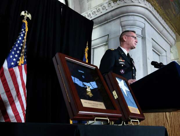 Major General Patrick Murphy speaks at the opening of an exhibit posthumously honoring Sgt. Henry Johnson, an Albany resident whose World War I heroism was recognized locally with the award of the Medal of Honor during a ceremony in the War Room at the State Capitol  Monday morning Oct. 9, 2015 in Albany, N.Y.  (Skip Dickstein/Times Union) Photo: SKIP DICKSTEIN / 10034142A