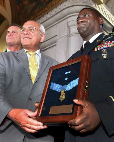 Major General Patrick Murphy, left, Congressman Paul Tonko, center and Command Master Sargent Anthony McLean gather at the opening of an exhibit posthumously honoring Sgt. Henry Johnson, an Albany resident whose World War I heroism was recognized locally with the award of the Medal of Honor during a ceremony in the War Room at the State Capitol  Monday morning Oct. 9, 2015 in Albany, N.Y.  (Skip Dickstein/Times Union) Photo: SKIP DICKSTEIN / 10034142A
