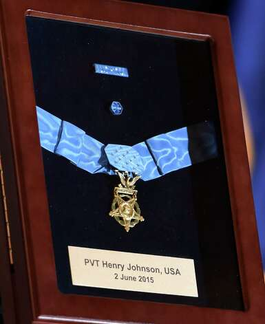 The Medal of Honor on display at the opening of an exhibit posthumously honoring Sgt. Henry Johnson, an Albany resident whose World War I heroism was recognized locally with the award of the Medal of Honor during a ceremony in the War Room at the State Capitol  Monday morning Oct. 9, 2015 in Albany, N.Y.  (Skip Dickstein/Times Union) Photo: SKIP DICKSTEIN / 10034142A