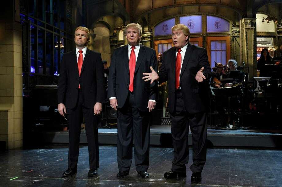 """Taran Killam, left,  Republican presidential candidate and guest host Donald Trump, center, and Darrell Hammond perform during the monologue on """"Saturday Night Live"""", Saturday, Nov. 7, 2015. Trump's 90 minutes in the """"SNL"""" spotlight followed weeks of growing anticipation, increasingly sharp criticism and mounting calls for him to be dropped from the show.  (Dana Edelson/NBC via AP) Photo: Dana Edelson, HONS / NBC"""