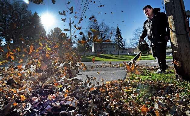 Joel Howard blows leaves from his father's driveway on Old Niskayuna Road Monday afternoon, Oct. 9, 2015, in Loudonville, N.Y.  (Skip Dickstein/Times Union) Photo: SKIP DICKSTEIN
