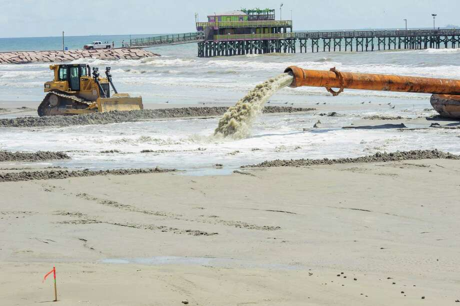 The first sand being dumped west of the 61st Street jetty to create new beaches between 61st and 81st streets. The sand is being hauled by boat from dredging operations in the Galveston Ship Channel to a barge offshore of the re-sanding operation. Pumps on the barge will suck the sand out of the boat and into a pipe that will carry it on to the beach.  09/04/15.   (Photos by ÂKim Christensen) Photo: ÂKim Christensen, Photographer / ©Kim Christensen