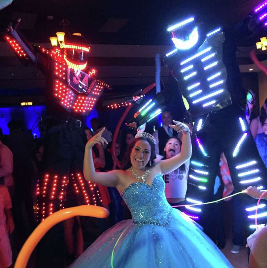 "Now that the glowing, towering bots have invaded dance floors across the city De Los Reyes said ""everybody's going crazy about it."" Photo: Provided By San Antonio Party Setup"
