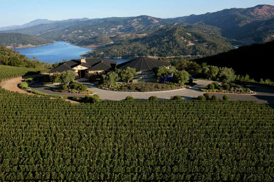 The Colgin winery in the Pritchard Hill area of St. Helena, Calif., offers a view of Lake Hennessey. Today its wines, though super pricey, sell themselves. / Colgin