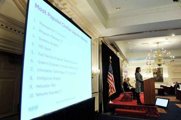 Amanda Hurley, with Monster.com, gives job searching tips to those attending the first Capital Region Extension of VOWS at The Desmond on Monday, Nov. 9, 2015, in Colonie, N.Y.  The daylong event brings veterans and employers together.  (Paul Buckowski / Times Union) Photo: PAUL BUCKOWSKI / 00034144A