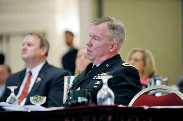 Brigadier General Michael Swezey listens to a speaker at the first Capital Region Extension of VOWS at The Desmond on Monday, Nov. 9, 2015, in Colonie, N.Y.  The daylong event brings veterans and employers together.   Brigadier General Swezey delivered the keynote address at the event.  (Paul Buckowski / Times Union) Photo: PAUL BUCKOWSKI / 00034144A