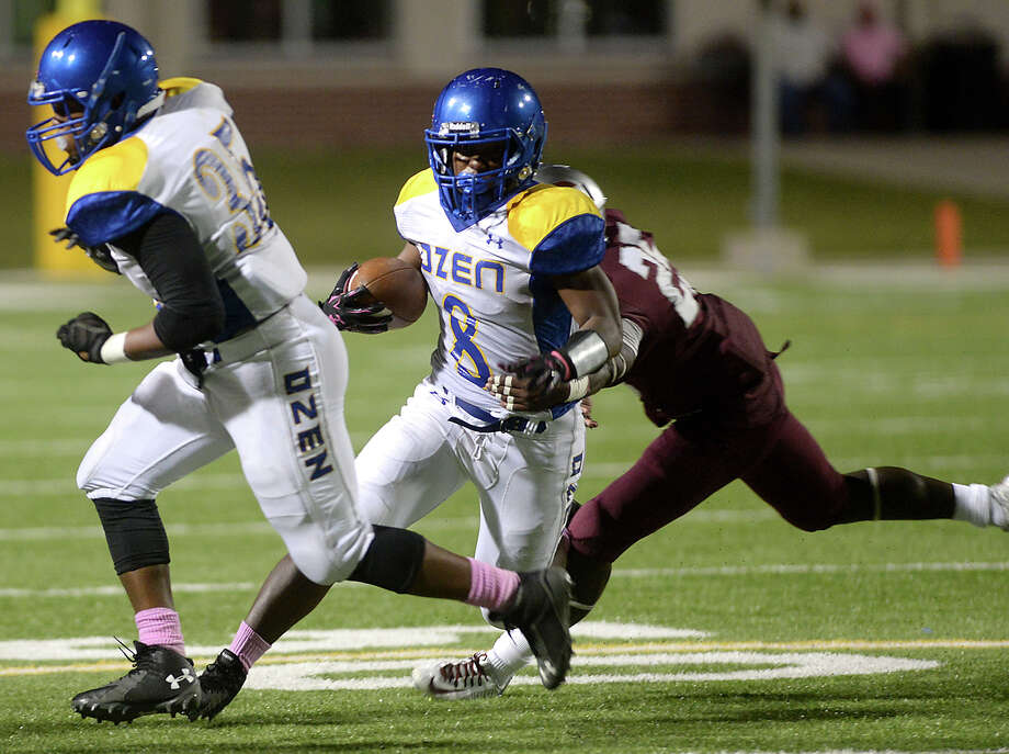 Ozen's junior running back Calvin Tyler Jr. set three school records and tied a fourth during a stellar regular season that saw him rush for 1,809 yards and 24 touchdowns. Central's Harold Redo tackles as Ozen's Calvin Tyler runs the ball during the annual Soul Bowl Friday night at the Thomas Center. The rivalry extends well beyond the playing field, with bands and fans looking to outdo one another in what is a highlight of Beaumont high schools' legendary rivalry. Photo taken Friday, October 16, 2015 Kim Brent/The Enterprise   Manditory Credit, No Sales, Mags Out, TV Out, Web: AP Members only Photo: Kim Brent / Beaumont Enterprise