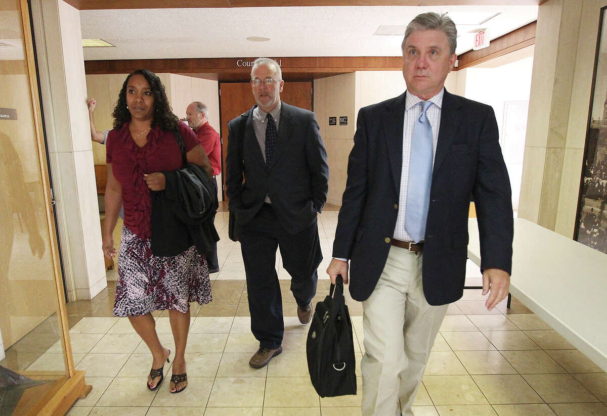 In this file photo from December 2013, Monique Rathbun (from left), her husband Marty and witness Mike Rinder leave the courtroom for a break from a hearing regarding Rathbun's lawsuit against the Church of Scientology for alleged harassment.
