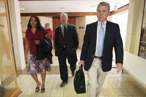 In this file photo from December 2013, Monique Rathbun (from left), her husband Marty and witness Mike Rinder leave the courtroom for a break from a hearing regarding Rathbun's lawsuit against the Church of Scientology for alleged harassment. A Texas appeals court last week rejected the church's attempt to fend off her lawsuit.