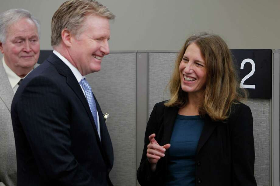 Secretary of Health and Human Services Sylvia Burwell confers with Michael Hill of Harris Health System this fall. She has said this could be a tough year for health care enrollment as it may be harder to reach those still uninsured. Photo: Steve Gonzales, Staff / © 2015 Houston Chronicle
