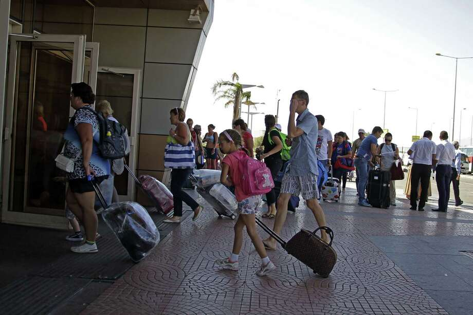 Russian passengers enter the Sharm el-Sheikh Airport on Monday in south Sinai, Egypt, where Airbus executives say they are confident in their safety after a jet crashed on Oct. 31, killing all aboard. Photo: Ahmed Abd El-Latif, STR / AP