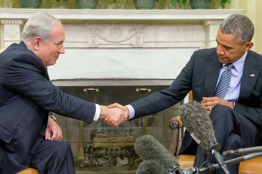 President Barack Obama shakes hands with Israeli Prime Minister Benjamin Netanyahu on Monday in the Oval Office. The two leaders sought to mend their fractured relationship during the meeting, their first in more than a year. Photo: Andrew Harnik, STF / AP