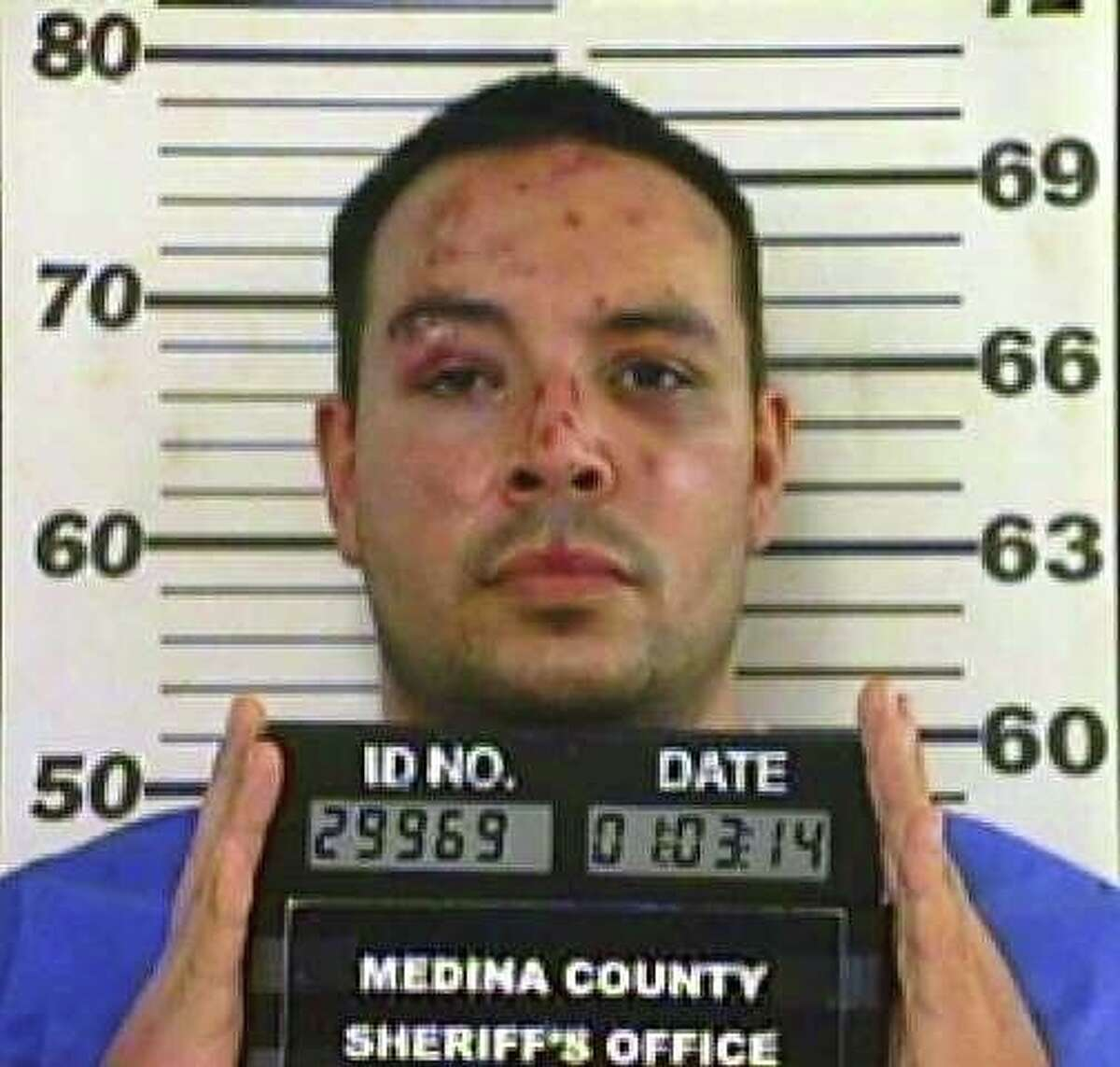 Border patrol agent Adam Scott Garibay is seen in a Jan. 3, 2014 booking mug provided by the Medina County Sheriff's department. Garibay pleaded guilty Nov. 9, 2015 to killing Keith Martin just outside Hondo.