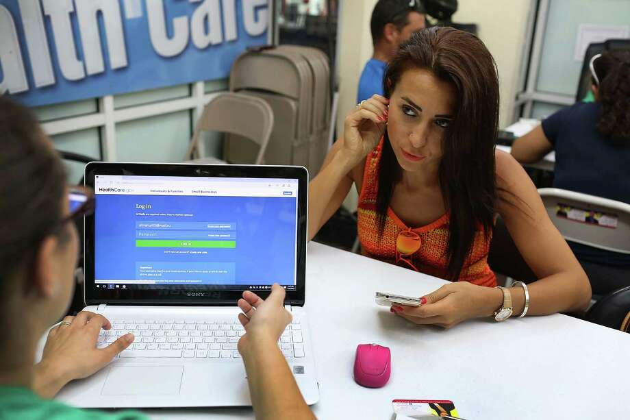 Alina Nurieva (right) sits with Gabriela Cisneros, an insurance agent from Sunshine Life and Health Advisors, as she picks an insurance plan available in the third year of the Affordable Care Act on Nov. 2. Photo: Joe Raedle /Getty Images / 2015 Getty Images