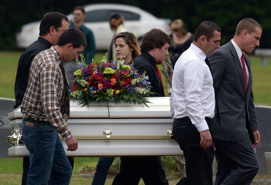 Pallbearers carry the casket of  6-year-old Jeremy Mardis to the grave site Monday at Beaumont Cemetery. Jeremy's father, Chris Few, remained hospitalized and could not attend the funeral. Photo: Eli Baylis, MBO / Hattiesburg American