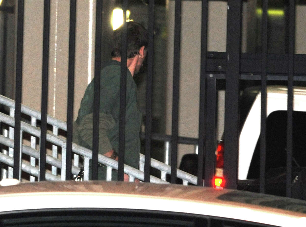 Edward Leon, 43, is taken out of the James T. Foley Federal Courthouse on Monday, Nov. 9, 2015 in Albany, N.Y. The St. Johnsville man is accused of lying to a grand jury about being near the scene of a May 2013 arson fire that killed a Schenectady man and three children. (Lori Van Buren / Times Union)
