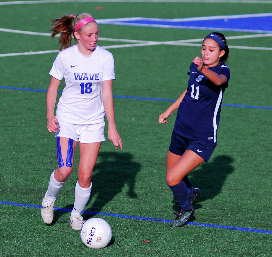 Darien's Katie Cronin, left, controls the ball while Staples' Tia Zajec chases during a girls soccer game in Darien, Connecticut on Monday, November 9th, 2015. Darien won 2-1 to advance to the Class LL second round. Photo: Ryan Lacey/Staff Photo / Westport News Contributed