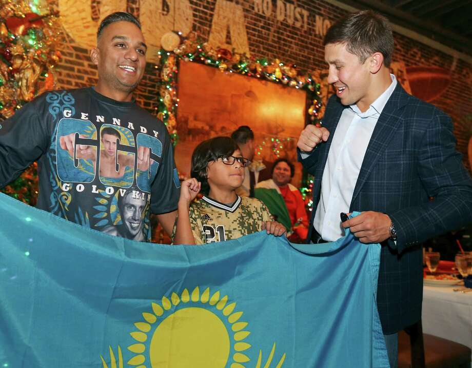 Boxing fans Julio Gonzalez (from left) and son Jadon, 9, pose for photos with middleweight Gennady Golovkin during his visit to Mi Tierra Cafe Y Panderia on Monday. Photo: Edward A. Ornelas / San Antonio Express-News / © 2015 San Antonio Express-News