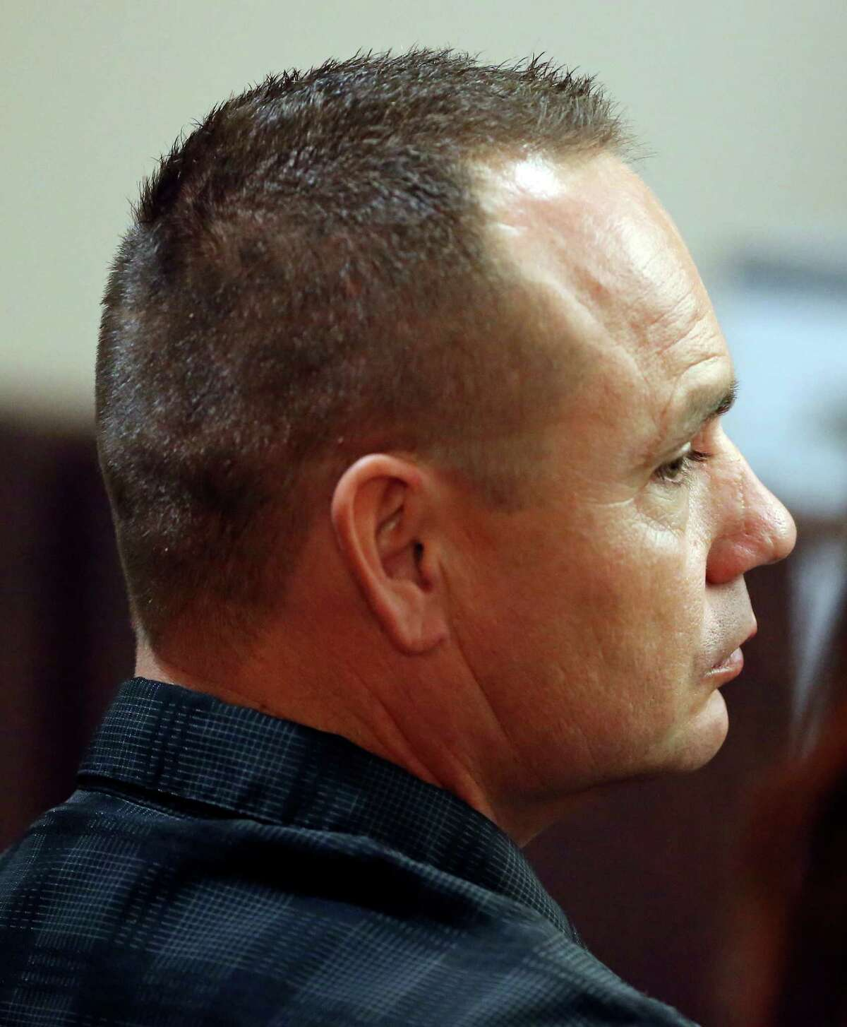 Former San Antonio police officer Jackie Len Neal waits for his sentencing in state District Judge Sid Harle's 226th state District Court Monday Nov. 9, 2015 at the Cadena-Reeves Justice Center. Neal was accused of raping a woman in the back of his patrol SUV in 2013. He was fined and sentenced to 14 months in a state jail facility as part of a plea agreement. Neal pleaded no contest to improper sexual activity with a person in custody. As part of the deal, he was fined $5,000 and agreed to surrender his peace officer certification.