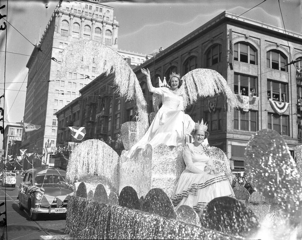 Portola Festival Parade Portola Festival Queen Ann Bucher is waving to the crowds, seated is Queen for a Day radio program winner Mrs. Dorothy Young Photos taken by Chronicle staff photographers Clem Albers, Ken McLaughlin Barney Peterson and Joe Rosenthal Photo ran 10/18/1948, p. 16