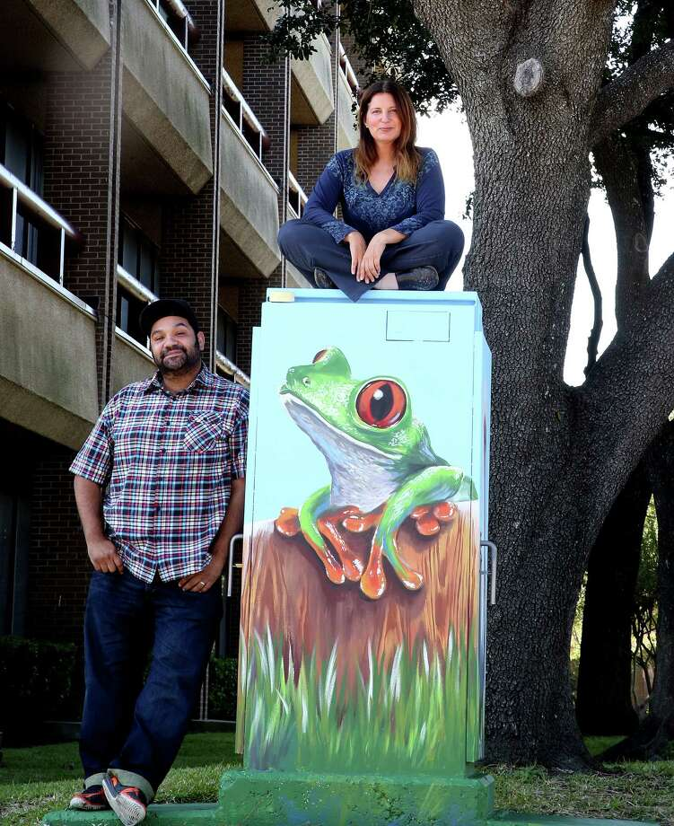 Studio owner Noah Quiles, left, and artist Anat Ronen check out the second mural Ronen created on a utility box in the Westchase District after the first was painted over by a graffiti abatement worker. Photo: Elizabeth Conley, Staff / © 2015 Houston Chronicle