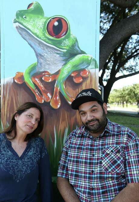 Muralist Anat Ronan and UP Art Studio's Noah Quiles in front of a Westchase District mini-mural that she painted as part of a city-sponsored project to beautify the city's utility boxes. In early November, the district's anti-graffiti task force mistakenly painted over Ronan's first attempt at the mural 20 hours after she finished it. Photo: Elizabeth Conley, Houston Chronicle / © 2015 Houston Chronicle