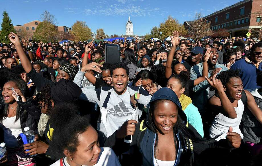 Student protesters on the campus of the University of Missouri in Columbia react to news of the resignation of University of Missouri system President Tim Wolfe on Monday, Nov. 9, 2015. Wolfe resigned under pressure from student protesters who claimed the president had not done enough to address recent racially-motivated incidents on the campus. Photo: David Eulitt, McClatchy-Tribune News Service / Kansas City Star