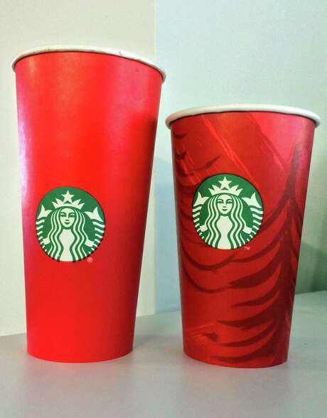These cups, debuted for the holidays by Starbucks earlier this month, have come under fire by some who say they don't emphasize Christmas enough.  Photo: KAREN BLEIER, Staff / AFP