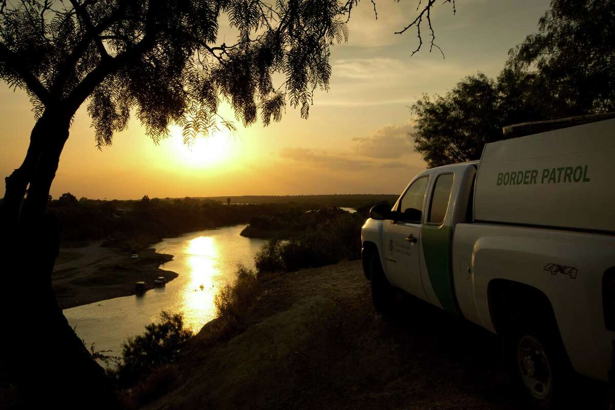 In this 2014 file photo, a U.S. Border Patrol agent keeps watch in Roma, Texas, across the Rio Grande River from Ciudad Miguel Aleman, Tamaulipas, Mexico. (Jay Janner/Austin American-Statesman via AP, File)