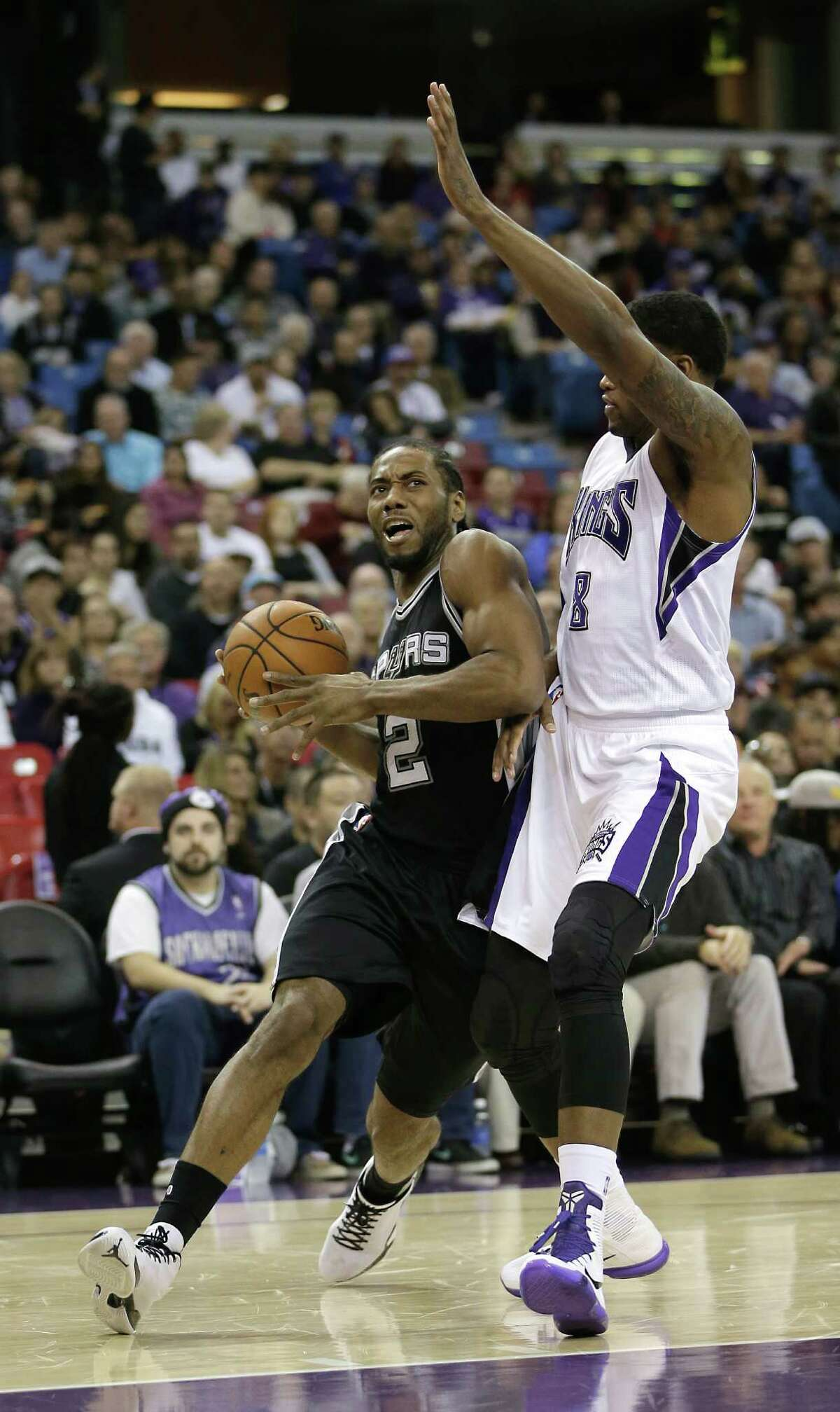 San Antonio Spurs forward Kawhi Leonard, left, drives against Sacramento Kings forward Rudy Gay during the first half of an NBA basketball game in Sacramento, Calif., Monday, Nov. 9, 2015. (AP Photo/Rich Pedroncelli)