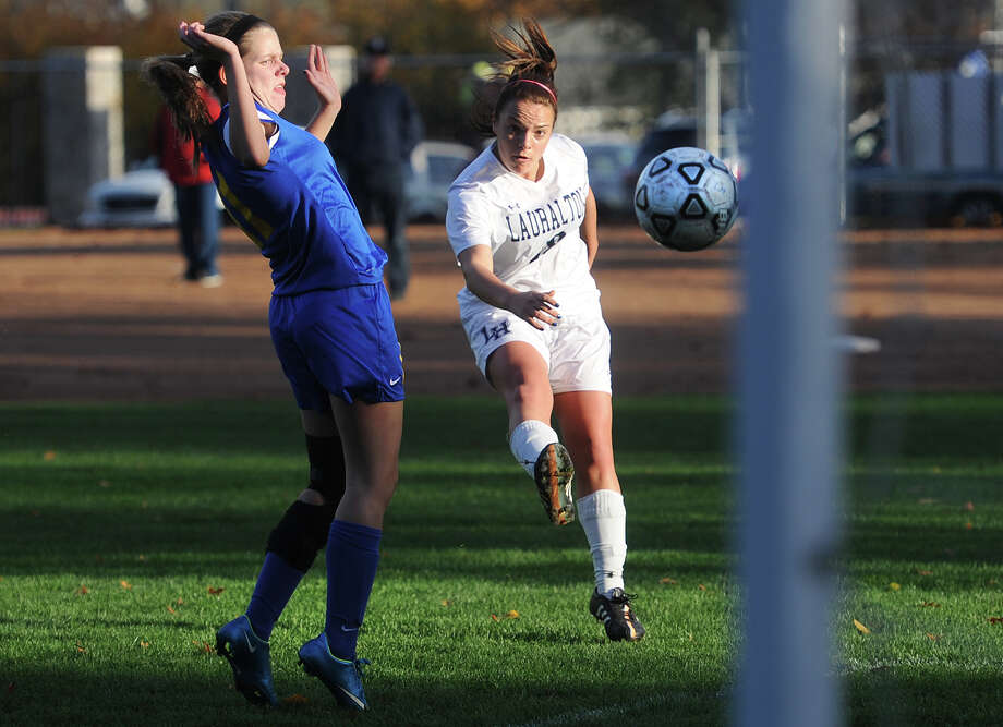 Lauralton Hall's Gianna Mecca boots in a goal while being defended by Rockville's Megan Hasty during their Class L state tournament first round game at Lauralton Hall in Milford, Conn. on Monday, November 9, 2015. Photo: Brian A. Pounds / Hearst Connecticut Media / Connecticut Post