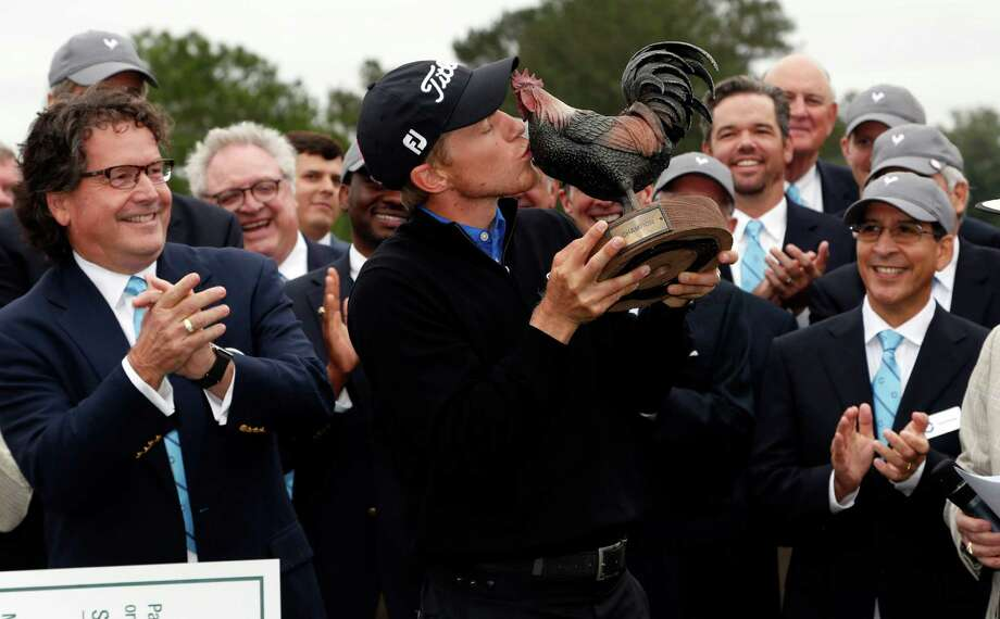 """Peter Malnati kisses """"Reveille,"""" the trophy he earned Monday for his one-stroke victory in the Sanderson Farms Championship at Jackson, Miss. Photo: Rogelio V. Solis, STF / AP"""