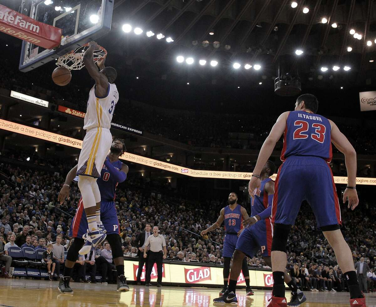 Festus Ezeli (31) dunks the ball in the first half as the Golden State Warriors played the Detroit Pistons at Oracle Arena in Oakland, Calif., on Monday, November 9, 2015.