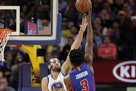 Andrew Bogut (12) defends against a shot by Stanley Johnson (3) in the first half as the Golden State Warriors played the Detroit Pistons at Oracle Arena in Oakland, Calif., on Monday, November 9, 2015.