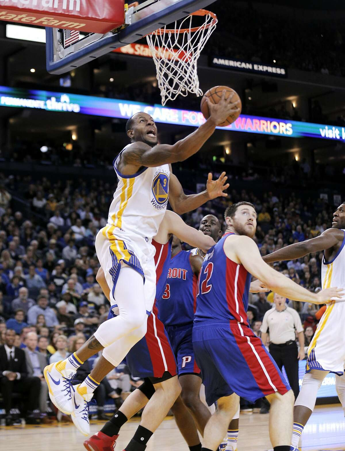 Andre Iguodala (9) drives under the basket in the first half as the Golden State Warriors played the Detroit Pistons at Oracle Arena in Oakland, Calif., on Monday, November 9, 2015.